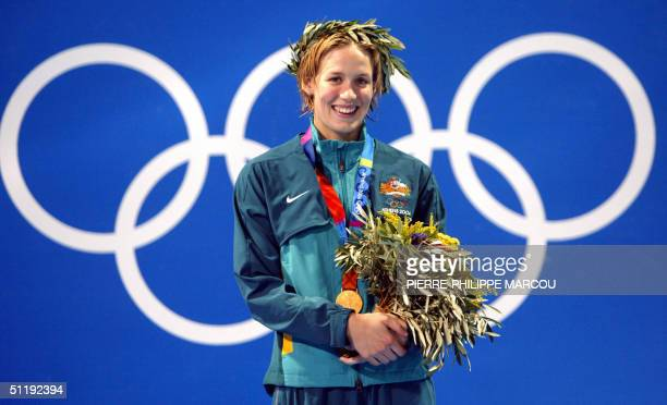 Jodie Henry from Australia pose on the podium after winning the women freestyle final at the 2004 Olympic Games at the Olympic Aquatic Center in...