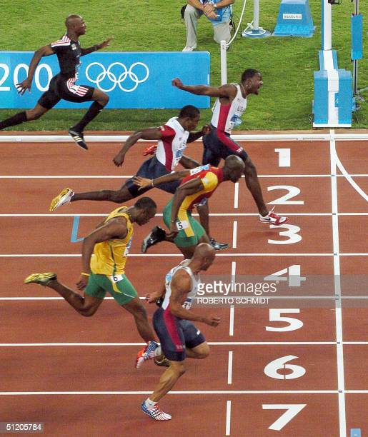 Justin Gatlin of the USA wins the men's 100m final ahead of Kim Collins of St Kitts and Nevis Shawn Crawford of the USA Portugal's Francis Obikwelu...