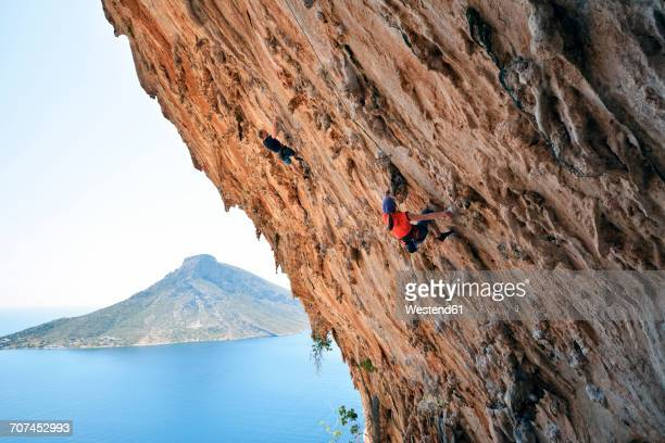Greece, Kalymnos, two climbers in rock wall