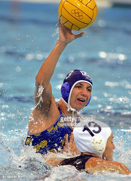 Kazakhstan's Tatyana Gubina shoots for goal during the women's preliminary group A match against Italy at the 2004 Olympic Games at the Olympic...