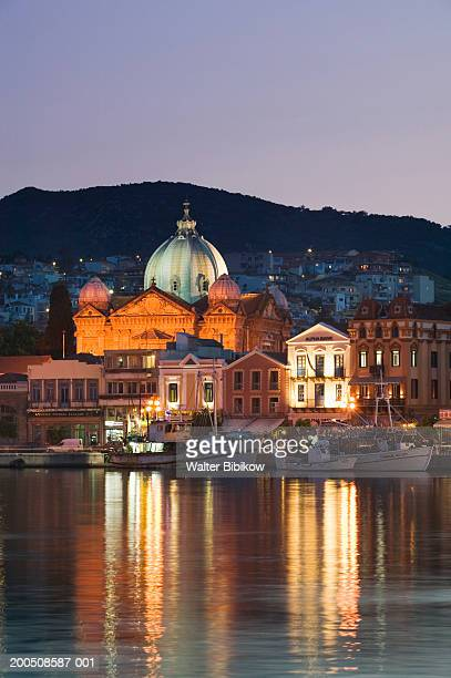 Greece, Lesvos, Mytilini town harbour and Agios Therapon Church, dusk