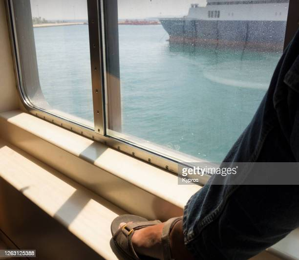 greece -  man wearing sandals on greek ferryboat - passagier wasserfahrzeug stock-fotos und bilder