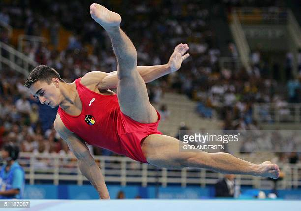 Marian Dragulescu of Romania performs on the floor 18 August 2004 at the Olympic Indoor Hall during the men's artistic gymnastics individual...