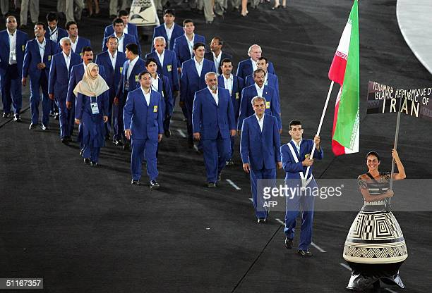 Members of the Iranian Olympic squad parade led by flag bearer judoka Arash Miresmaeili entry into the Olympic stadium in Athens 13 August 2004 at...