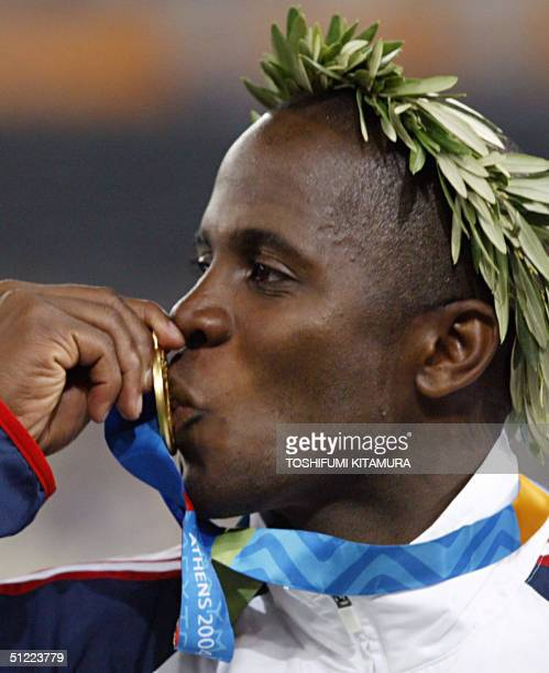 Men's long jump gold winner Dwight Phillips of the USA kisses his medal 26 August 2004 during the Olympic Games athletics competitions at the Olympic...