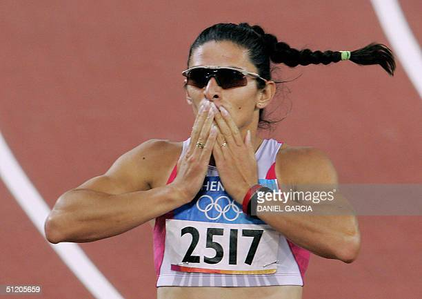 Mexico's Ana Guevara blows a kiss to the crowd after she won semifinal one of the women's 400m 22 August 2004 during the Olympic Games athletics...