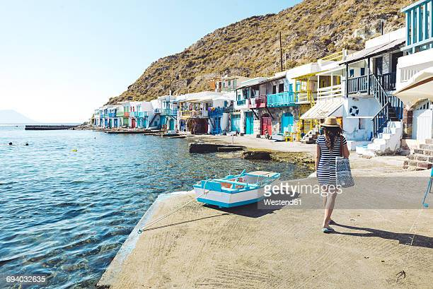 Greece, Milos, Woman walking in the colorful fishermen's village Klima