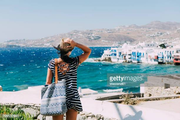 greece, mykonos, back view of tourist looking to little venice - incidental people stock pictures, royalty-free photos & images