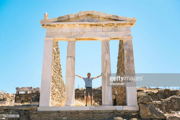 Greece, Mykonos, Delos, tourist visiting the Temple of Isis