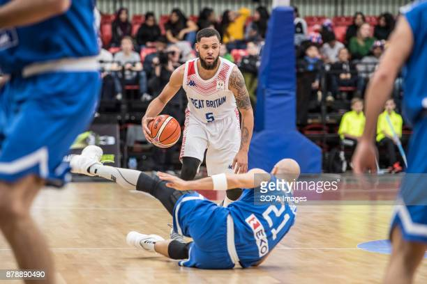 Greece Panagiotis Vassilopoulos loses his footing against Great Britain Teddy Okereafor during the FIBA World Cup qualifiers between Great Britain...
