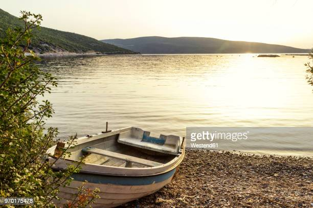 Greece, Pelion, Pagasetic Gulf, boat at the beach at sunset