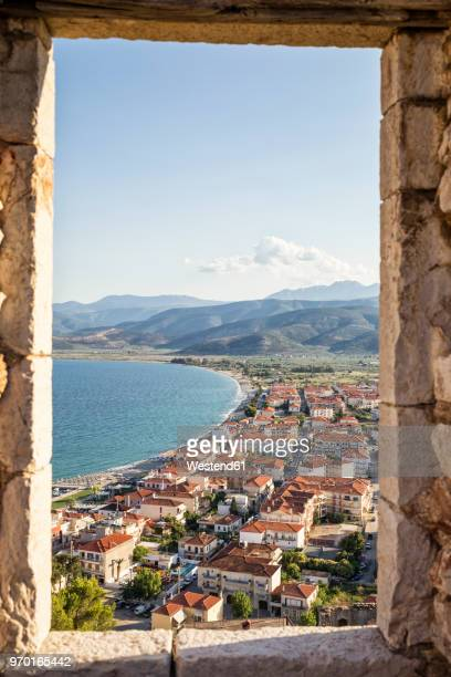 greece, pelopnnes, view on paralia astros through castle window - peloponnese stock photos and pictures