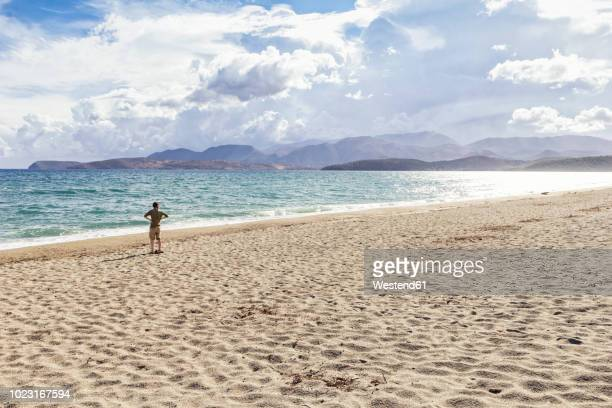 greece, peloponnese, mani peninsula, man at the beach of mavrovouni - peninsula de grecia fotografías e imágenes de stock