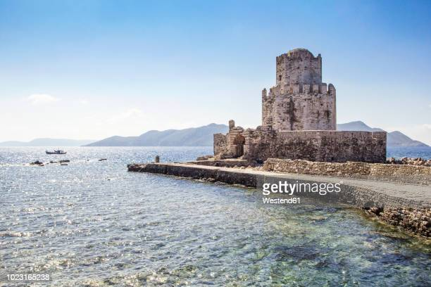 greece, peloponnese, messenia, methoni, fortress, tower burtzi and sapientza island in the background - isla de antigua fotografías e imágenes de stock