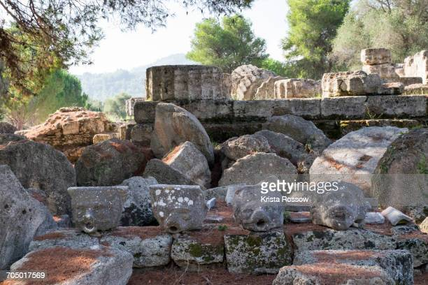 Toppled columns and lion head decorative elements at the Temple of Zeus.
