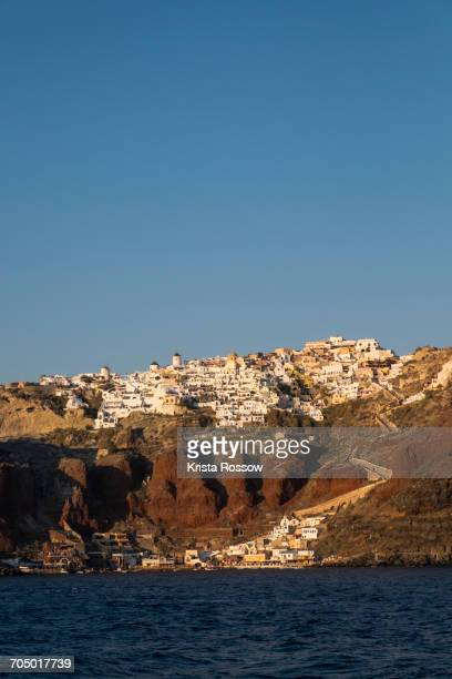 """The town of Oia with its steep donkey path leading from the port up to the main town, which is perched on the caldera cliff in Santorini."""