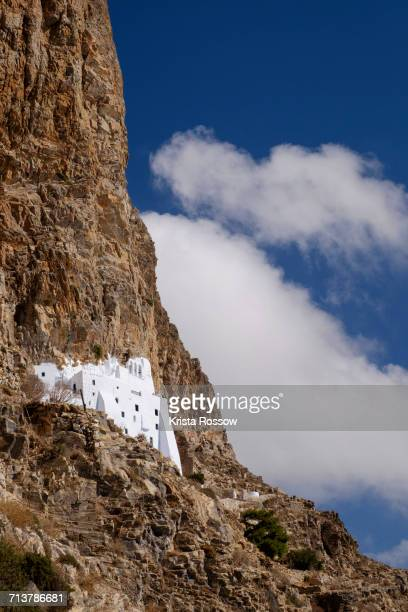 The whitewashed Monastery of Panagia Hozoviotissa on the Cycladic island of Amorgos clings to a cliff high above the Aegean Sea in Greece.