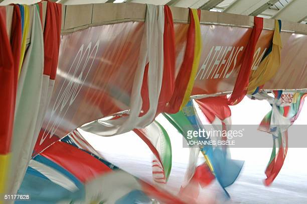Picture shows flags moving with the wind at the Velodrome in Athens 16 August 2004 four days before the start of the cycling track competition at the...