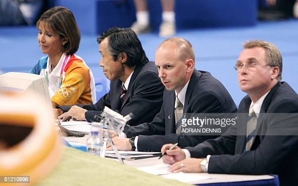 Picture taken 23 August 2004 of the judges after the performance of Russia's Alexei Nemov's during the men's horizontal bar final at the Olympic...