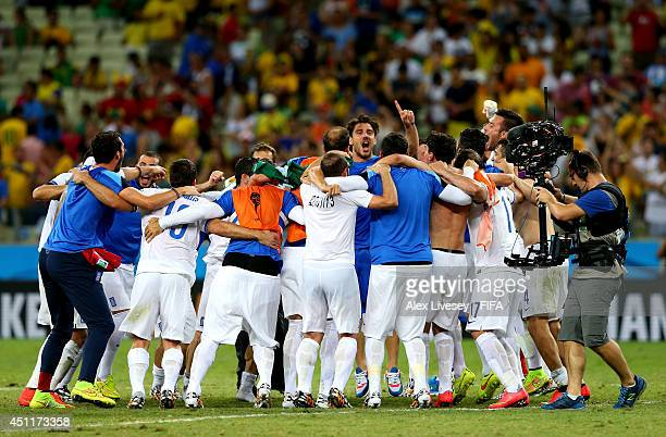 Greece players celebrate the 21 win after the 2014 FIFA World Cup Brazil Group C match between Greece and Cote D'Ivoire at Estadio Castelao on June...