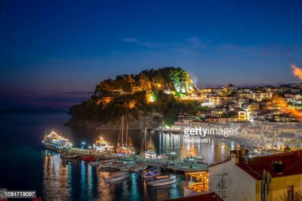 greece, preveza, parga, illuminated marina of resort town on ionian coast at summer night - epirus greece stock pictures, royalty-free photos & images