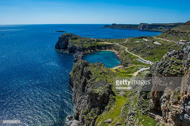 greece, rhodes, lindos, st. paul beach - rhodes dodecanese islands stock photos and pictures