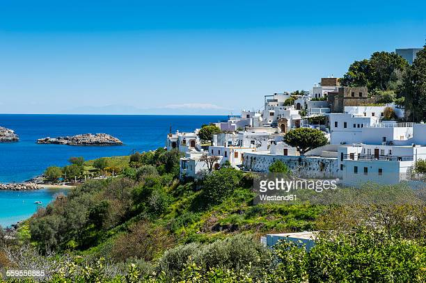 greece, rhodes, white houses of the town of lindos - lindos stock photos and pictures