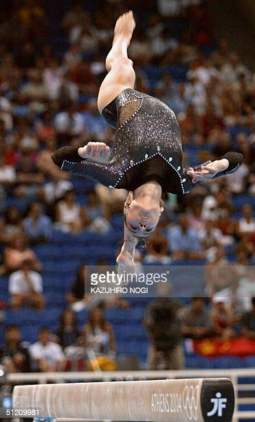 Romania's gold medallist Catalina Ponor performs during the women's beam final, 23 August 2004 at the Olympic Indoor Hall in Athens during the...