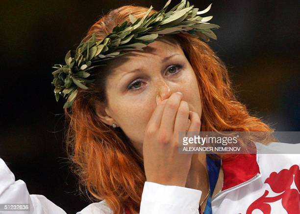 Russian volleyball player Elizaveta Tishchenko celebrates her silver medal on the podium at the end of the volleyball tournament at the Olympic Games...