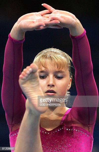 Russia's Anna Pavlova performs during the women's beam final 23 August 2004 at the Olympic Indoor Hall in Athens during the Olympics Games AFP PHOTO...