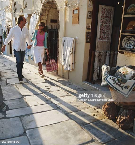 Greece, Santorini Island, Oia, couple holding hands in street