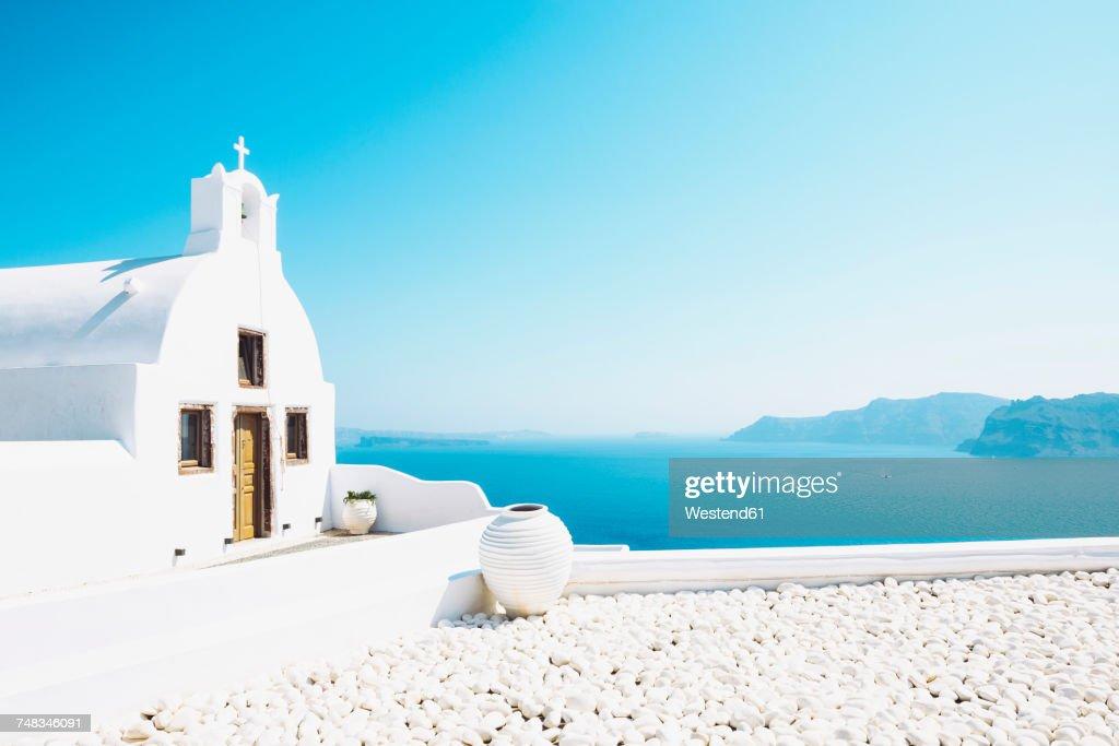 Greece, Santorini, Oia, Byzantine Orthodox church over the sea : Stock Photo