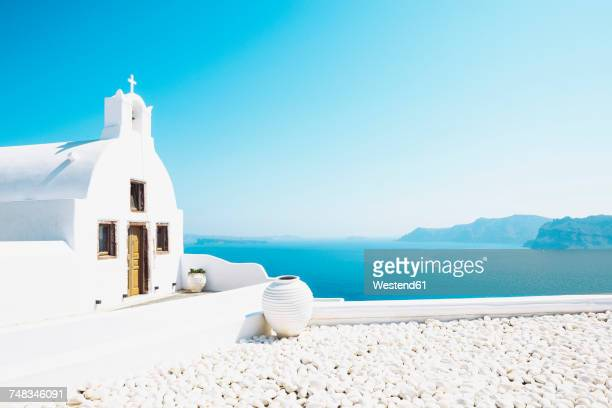 greece, santorini, oia, byzantine orthodox church over the sea - greece stock pictures, royalty-free photos & images