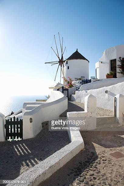 Greece, Santorini, Oia, hillside street with windmill