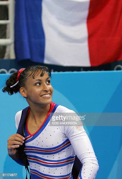 Soraya Chaouch of France leaves the Olympic Indoor Hall after not being qualified for the women's Artistic Gymnastics final 15 August 2004 during the...