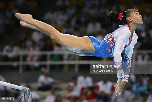 Soraya Chaouch of France performs on the uneven bars in the women's Artistic Gymnastics qualifications 15 August 2004 at the Olympic Indoor Hall...