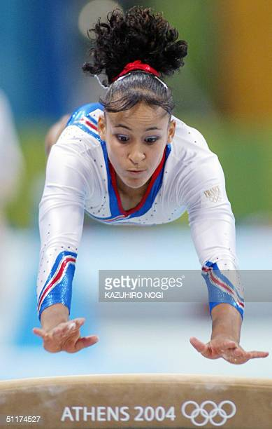 Soraya Chaouch of France performs on the vault in the women's Artistic Gymnastics qualifications 15 August 2004 at the Olympic Indoor Hall during the...
