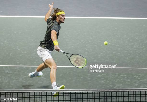 Greece' Stefanos Tsitsipas returns the ball to Russia's Karen Khachanov on the fifth day of the ABN AMRO World Tennis Tournament in Rotterdam, The...