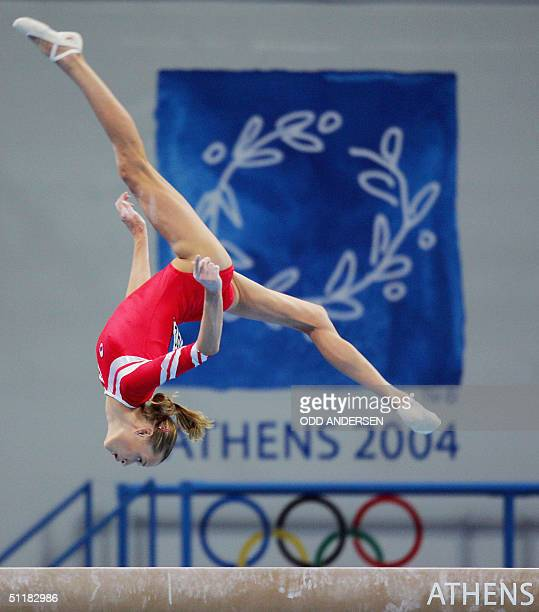 Svetlana Khorkina of Russia performs on the beam 17 August 2004 at the Olympic Indoor Hall during the women's artistic gymnastics team final of the...