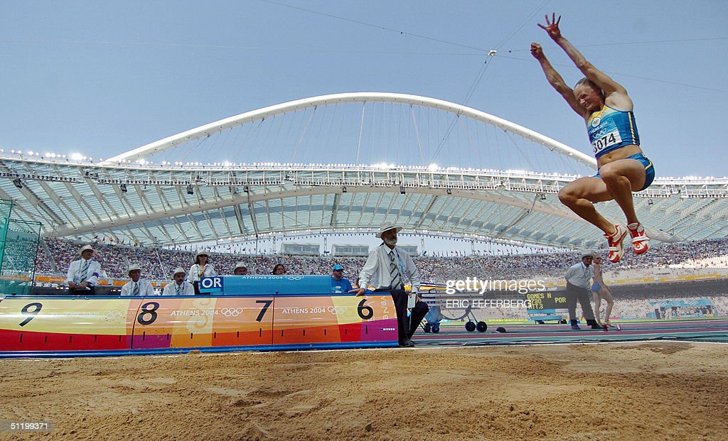 Sweden's Carolina Kluft competes during the women's heptathlon long jump at the Olympic Stadium 21 August 2004 during the Olympic Games in Athens. World champion Carolina Kluft lived up to her favourite's tag on the first day of the heptathlon at the Olympic Games on Friday as she took a commanding lead into the second day.