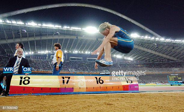 Sweden's Christian Olsson competes during the men's triple jump final at the Olympic Stadium 22 August 2004 during the Olympic Games in Athens Olsson...
