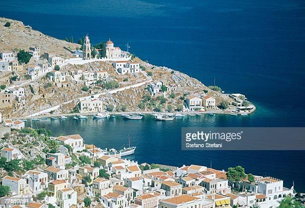 greece, symi, coastline, high angle view - dodecanese islands stock photos and pictures