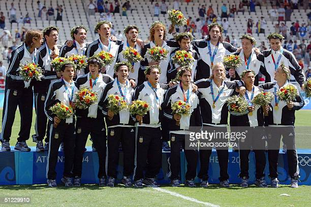 The Argentine's national football team celebrates with their gold medal on the podium of the 2004 Olympic Games tournament at the Olympic Stadium in...