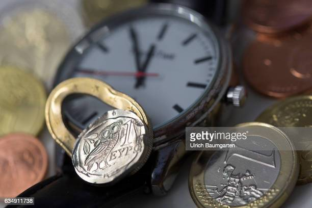 Greece the European Union and continue the danger of a Grexit The symbol photo shows a clock with the display five minutes to twelve and a crushed...