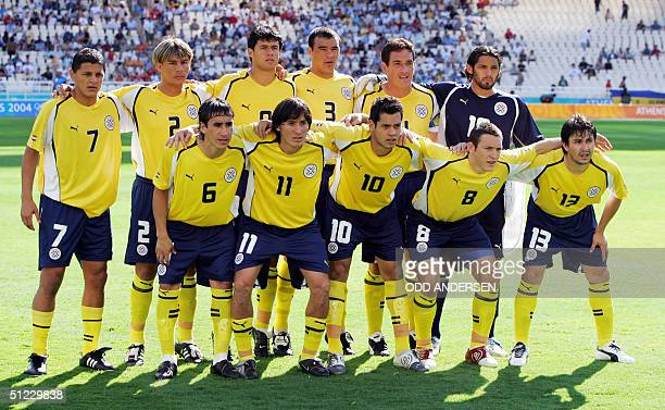The Paraguayan team poses at the Olympic Stadium in Athens 28 August 2004 before the Olympic men's football final against Argentine of the 2004...