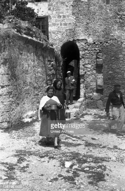 Greece - The women have cooked and are taking the food outside, Greece, 1950s. Wife prepared lunch and takes it outside, Greece, 1950s.