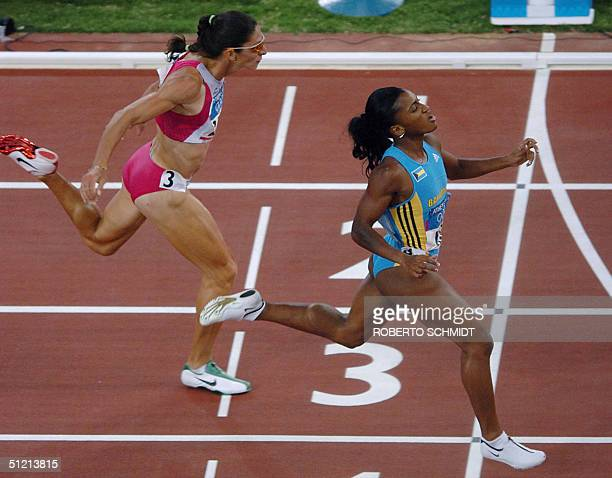 Tonique WilliamsDarling of the Bahamas finishes first for the gold in the women's 400m final 24 August 2004 ahead of silver winner Ana Guevara during...