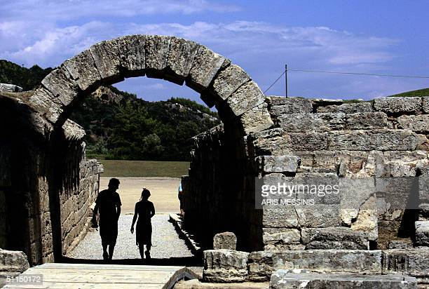 Tourists enter the ancient stadium of Olympia where the Olympic Games were born in 776 BC 07 August 2004 Ancient Olympia about 325 kilometers west of...