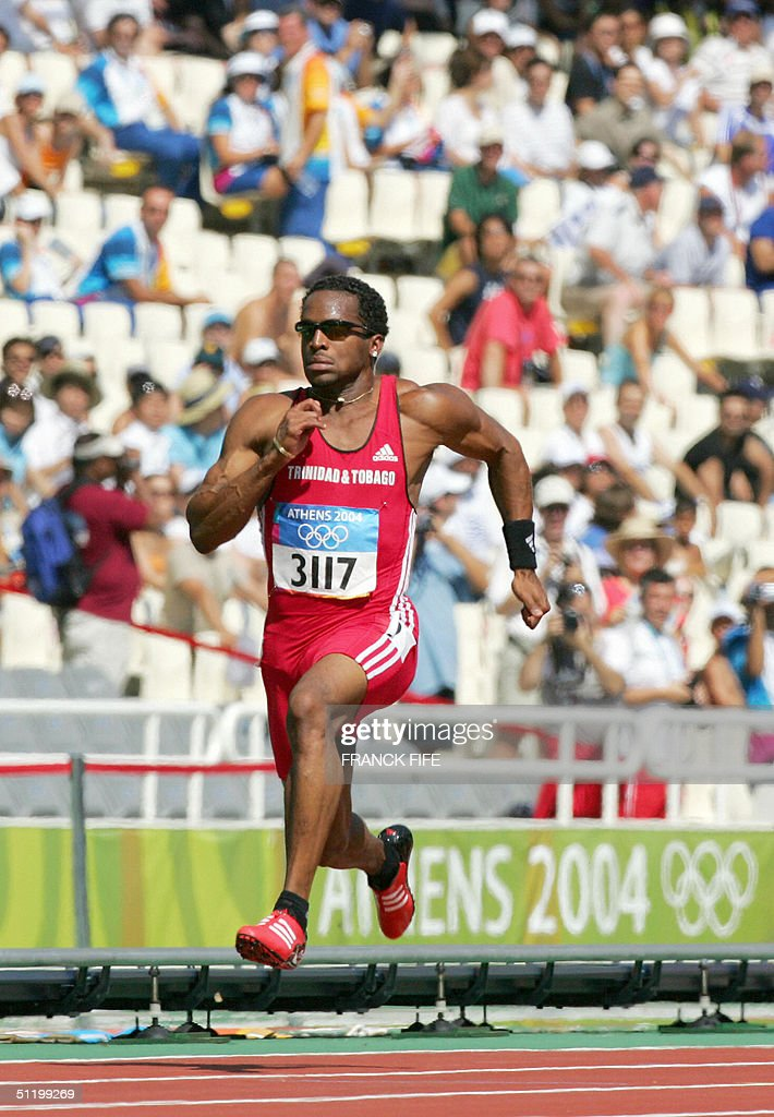 Trinidad and Tobaggo's Ato Boldon competes in the men's 100m round 1 at the Olympic Stadium 21 August 2004 during the Olympic Games in Athens.