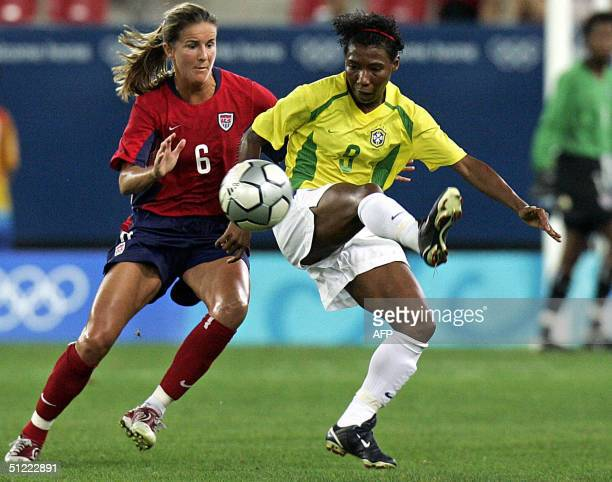US defender Brandi Chastain and Brazilian forward Pretinha try to intercept the ball during their gold medal football match at the Olympic Games 26...